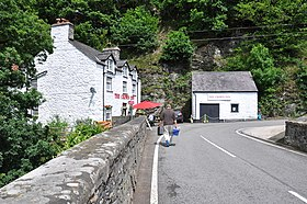Looking over the bridge to The Crown Inn at Llanfihangel Glyn Myfyr - geograph.org.uk - 3026756.jpg