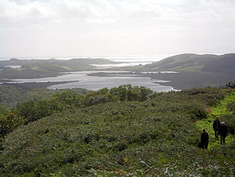Loch Sween - Looking south over Linne Mhuirich from Taynish, across to the Ulva islands, Druim Mòr and Danna. The main body of Loch Sween is to the left.