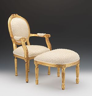 Fauteuil - Louis XVI style fauteuil gold foiled chair with faux pearls and ottoman.