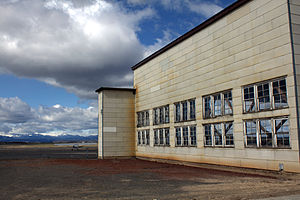 Madras Municipal Airport - Old hangar, plane, and mountains