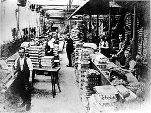 Blackburn - Workers producing shuttles for the textile industry, c. 1920. Rowland Baguley and Company, based on Addison Street, produced a wide range of shuttles for the home textile industry and for export before it closed in the early 1930s.