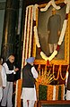 Manmohan Singh paying homage at the portrait of the first President of India, Late Dr. Rajendra Prasad, on the occasion of his 123rd birth anniversary, at Central Hall, Parliament House in New Delhi on December 03, 2007.jpg