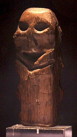 An oak figurine found in Willemstad, the Netherlands, dating from around 4500 BC. On display in the Rijksmuseum van Oudheden in Leiden. Height: 12.5 cm (4.9 in). Mannetje van Willemstad.jpg