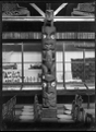 Maori wood carving; a carved centre pole. ATLIB 255479.png