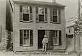 Mark Twain in front of boyhood home in Hannibal.jpg