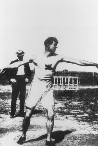 Athletics at the 1904 Summer Olympics – Men's discus throw - Martin Sheridan throws the discus on the way to finishing with the gold.