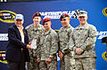 Martinsville Speedway President Clay Campbell presents (from left) Army Pfc. Albert Boston, a human resources clerk for the Headquarters and Headquarters Detachment, 2nd Battalion, 3rd Special Forces Group, Sgt 121028-A-ZZ999-002.jpg