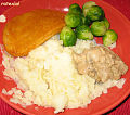Mashed potatoes, vegan schnitzel, brussel sprouts, mushroom sauce (3076343497).jpg