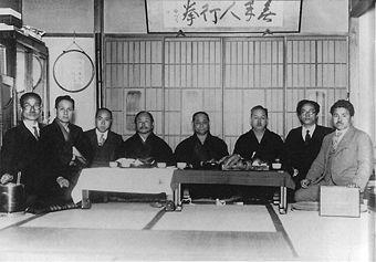 Masters of karate in Tokyo (c. 1930s) Kanken Toyama, Hironori Ohtsuka, Takeshi Shimoda, Gichin Funakoshi, Choki Motobu, Kenwa Mabuni, Genwa Nakasone, and Shinken Taira (from left to right)