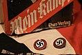 Mein Kampf Eher Verlag detil. German Nazi NSDAP member pins badges. Baugnez 44 Historical Center WW2 museum 2012.jpg