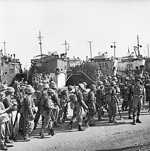 152nd Infantry Brigade (United Kingdom) - Men of the 2nd Battalion, Seaforth Highlanders embarking onto landing craft at Sousse, Tunisia, en route for Sicily, 5 July 1943.