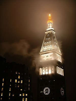 Metropolitan Life Insurance Company Tower - The top of the Met Life Tower in fog at night
