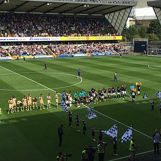 Leeds United F.C.–Millwall F.C. rivalry - The teams line up at The Den (9 August 2014)