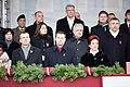 Ministru prezidents Valdis Dombrovskis vēro Nacionālo bruņoto spēku vienību militāro parādi 11.novembra krastmalā (6357756275).jpg