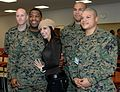 Model Mayra Verónica poses for a photo with Marines at Landstuhl Regional Medical Center (071124-F-6684S-303).jpg