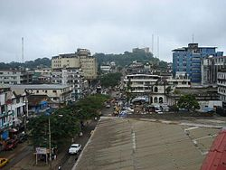 Broad Street, Monrovia, Liberia. The Old Ducor Hotel is visible in the background.