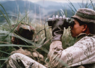 Degar - 1st Cav LRRP Montagnards scanning for enemy troops, March 1968