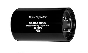 Motor capacitor - A typical motor start capacitor, as can be seen by its black colour and can shape