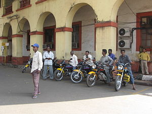 Motorcycle taxi - Pilots wait for customers at a motorcycle taxi stand in Vasco da Gama, Goa