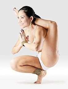 220px Mr yoga one foot behind head tiptoe pose yoga asanas Liste des exercices et position à pratiquer