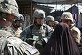 Multi-National Division – Baghdad Deputy Commander visits Doura Market DVIDS39076.jpg