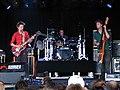 Muse at Roskilde Festival 2000 (4688235497).jpg