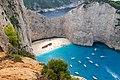 Navagio Beach and wreck of the MV Panagiotis (31530077597).jpg