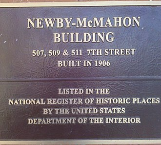 "World's littlest skyscraper - Plaque attached to the Newby-McMahon Building, also known as the ""world's littlest skyscraper"". This plaque refers to the building adjacent to the ""skyscraper"" which was completed in 1906, the ""skyscraper"" building was completed in 1919."