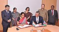 Nirmala Sitharaman and the Deputy Minister of Industrialisation, Trade and SME Development, Namibia, Mr. Piet Van der Walt signing an agreement, during the Third Session of the India-Namibia Joint Trade Committee.jpg