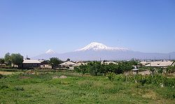 Nor Kyurin (foreground), Marmarashen (background with unfinished church), and Mt. Ararat, May 2009.