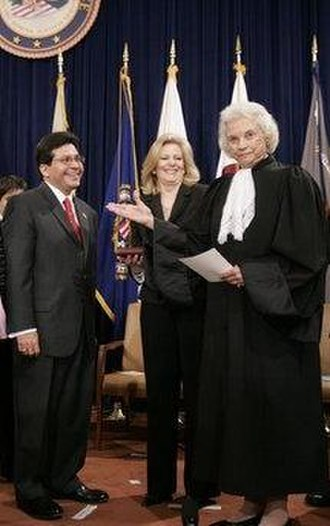 Sandra Day O'Connor - Justice O'Connor presents Alberto Gonzales to the audience after swearing him in as U.S. Attorney General, as Becky Gonzales looks on.