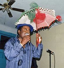 Oliver Morgan on stage with his trademark second-line umbrella, 1997