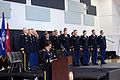 Oregon State University ROTC cadets stand during the playing of the National Anthem (9073166194).jpg