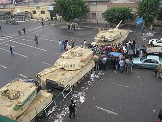 Martial law - Martial law in Egypt: Egyptian-flagged tanks man an apparent checkpoint just outside the midtown Tahrir area during the 2011 Egyptian revolution.