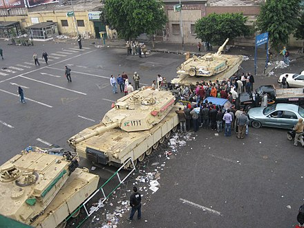 Martial law in Egypt: Egyptian-flagged tanks man an apparent checkpoint just outside the midtown Tahrir area during the 2011 Egyptian revolution. Outside midtown of Tahrir area, Cairo during martial law, 4 February 2011.jpg