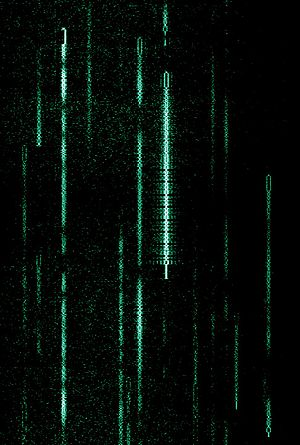 PSK31 - A waterfall display depicting several PSK31 transmissions at around 14,070 kHz. The green lines indicate a station that is transmitting.