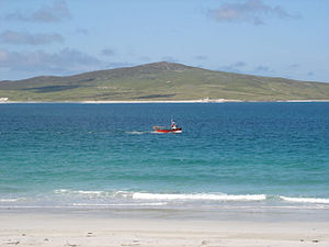 Berneray (North Uist) - A fishing boat passes between the west beach of Berneray and the island of Pabbay