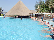 People tourists in swimming pool hotel Gambia