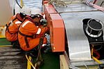 Personnel conduct maintenance of the Dragon Prince deep tow fish on the back deck of Fugro Discovery (2).jpg