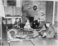 Photograph of Mike, Jack, Steve, and Susan Ford (children of Gerald and Betty Ford) Playing with an Electric Train at... - NARA - 187046.tif