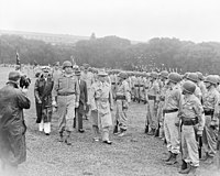 Photograph of President Truman walking past members of the Nisei 442nd Regimental Combat Team as they stand at... - NARA - 199390.jpg