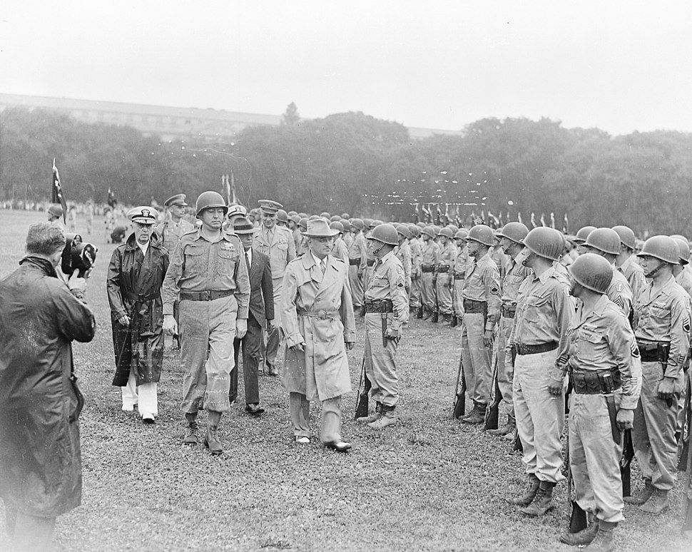 Photograph of President Truman walking past members of the Nisei 442nd Regimental Combat Team as they stand at... - NARA - 199390