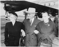Photograph of President Truman with Mrs. Truman and their daughter, Margaret, at Washington National Airport prior to... - NARA - 200246.tif