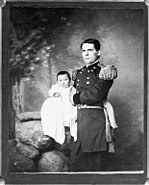 Portrait of General L. W. Colby of Nebraska State Troops Holding Baby Girl, Zintkala Nuni (Little Lost Bird), Found On Wounded Knee Battlefield, South Dakota, 1890 n.d