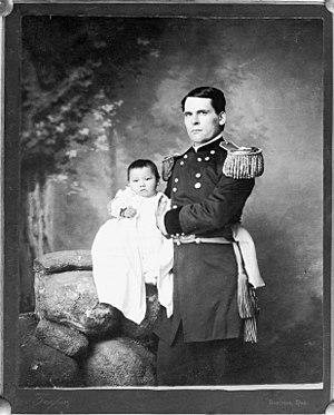 Clara Bewick Colby - Portrait of General L. W. Colby of Nebraska State Troops holding baby girl, Zintkala Nuni (Little Lost Bird), found on the Wounded Knee Battlefield, South Dakota, 1890