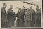 Portrait of two aviators, one male and one female, being welcomed by five unidentified men, Bathurst, 1932 - Martin Studio (15667321174).jpg