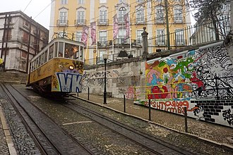Ascensor da Glória - The graffiti-painted tram, passing along the hill in 2015