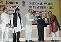 Pranab Mukherjee presenting the National Award for Teachers-2012 to Shri Sudarshan Kumar, Haryana, on the occasion of the 'Teachers Day', in New Delhi. The Union Minister for Human Resource Development.jpg