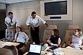 President Barack Obama talks with staff.jpg