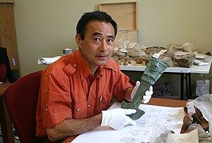 Izumi Shimada - Professor Izumi Shimada holding tumi knife excavated at Huaca Loro in 2006